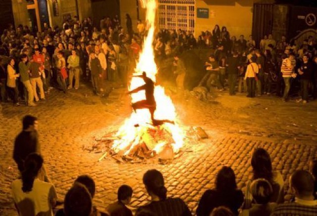 Jumping bonfires in the celebrations of San Xoan Galicia