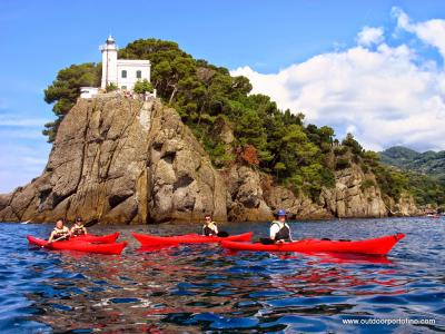 Kayaking along Portofino's lighthouse (Liguria, Italy)
